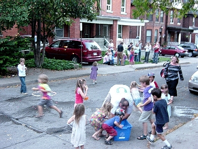Children armed with water balloons overrun Max in a swarm. (Photo Credit: Ryan McGreal)