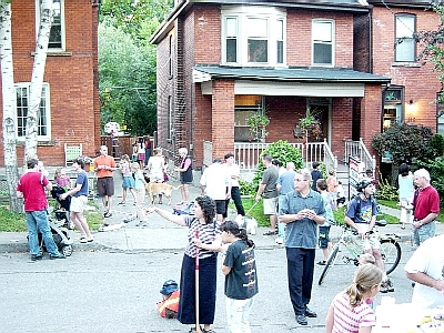 Residents and visitors enjoy a chance to stand on the street. (Photo Credit: Ryan McGreal)