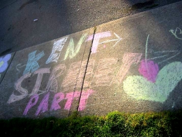 Children decorated the sidewalk with art and messages of good will. (Photo Credit: Jen Dawson)